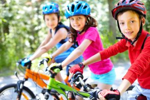 three children on bikes